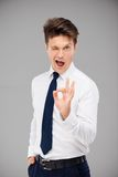 Young man showing ok sign Stock Photography