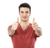 Young man showing OK sign with his thumb up. On white Stock Image