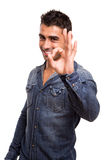 Young man showing Ok sign. Portrait of a young man showing Ok sign Royalty Free Stock Image