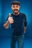 The young man showing the ok thumbs up hand sign royalty free stock photos