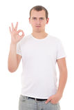 Young man showing okay sign isolated on white background Stock Photo