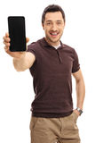 Young man showing a phone Stock Photo