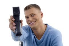 Young man showing phone receiver Royalty Free Stock Images