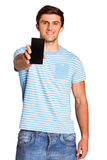 Young man showing phone to camera Royalty Free Stock Image