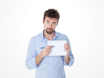 Young man showing a point on his white notebook Stock Photography