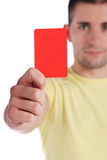 Young man showing red card Stock Photo