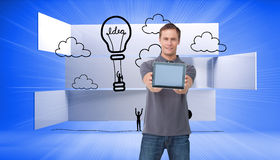 Young man showing screen of his tablet computer Royalty Free Stock Photo
