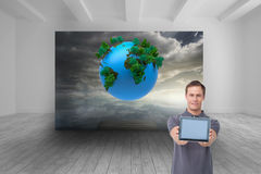 Young man showing screen of his tablet computer Royalty Free Stock Photography