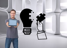 Young man showing screen of his tablet computer Royalty Free Stock Image