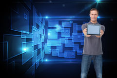 Young man showing screen of his tablet computer. Composite image of young man showing screen of his tablet computer Royalty Free Stock Photo