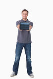 Young man showing screen of tablet computer Stock Photos