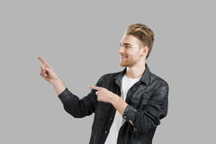 Young man showing something Stock Photography