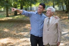 Young man showing something grandfather Royalty Free Stock Photography