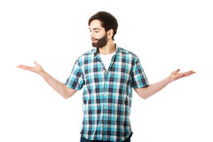 Young man showing something in hands. Stock Images