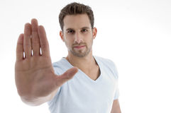 Young man showing stop gesture. On an isolated white backgound Royalty Free Stock Images