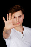 Young man showing stop sign. Royalty Free Stock Image