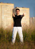 Young man showing success handsign Royalty Free Stock Image