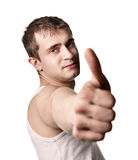 Young man showing thumb up Stock Images