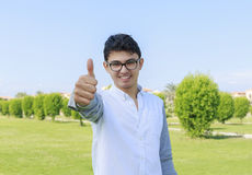 Young man showing the thumb up with great smile. Stock Image