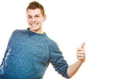 Young man showing thumb up hand sign gesture Royalty Free Stock Photo