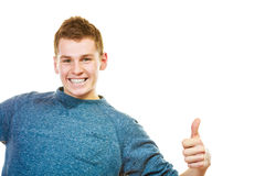 Young man showing thumb up hand sign gesture Stock Images