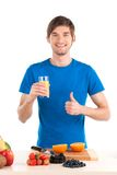 Young man showing thumb up and smiling. Royalty Free Stock Images