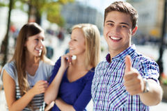 Young man showing thumbs up Stock Photography