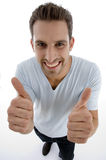 Young man showing thumbs up gesture. On an isolated white backgound Royalty Free Stock Photos