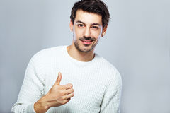 Young man showing thumbs up Royalty Free Stock Photos