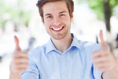 Young man showing thumbs up Stock Image