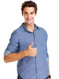 Young man showing thumbs up sign Stock Images