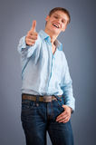 Young man showing thumbs up sign. Portrait of a young man showing thumbs up sign Royalty Free Stock Photo