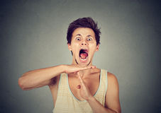 Young man showing time out hand gesture, frustrated screaming Royalty Free Stock Images