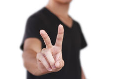 Young man showing two fingers or victory gesture,  over. White background Stock Images