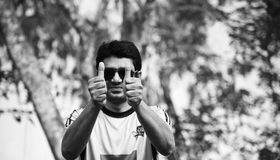 Young man showing two thumbs with hands royalty free stock photo