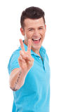 Young man showing victory sign Stock Photography