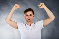 Young man showing winner gesture. Royalty Free Stock Photo