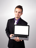 Young man showing a work presentation on laptop Stock Photo