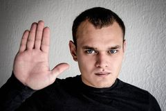 A young man shows emotion. In a black jacket Stock Photos