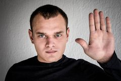 A young man shows emotion. In a black jacket Stock Photography