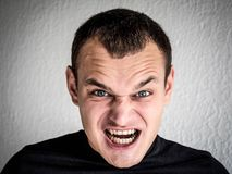 A young man shows emotion stock photo