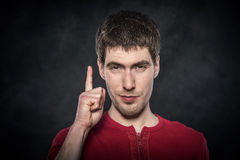 Young man shows finger up. Royalty Free Stock Images