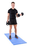 Young man shows finishing position of biceps curl Royalty Free Stock Images