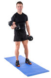 Young man shows finishing position of biceps curl Royalty Free Stock Image