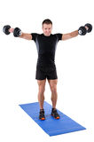 Young man shows finishing position of dumbbell Royalty Free Stock Photos
