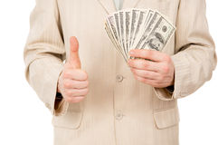 A young man shows that he has is there are us dollars Royalty Free Stock Photos