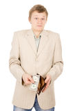 A young man shows that he has in the wallet a one dollar Royalty Free Stock Photo