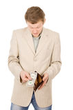 A young man shows that he has in the wallet a one dollar Royalty Free Stock Images