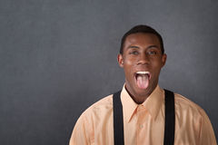 Young Man Shows His Tongue Royalty Free Stock Image