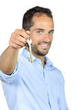 A young man shows house keys Royalty Free Stock Photography